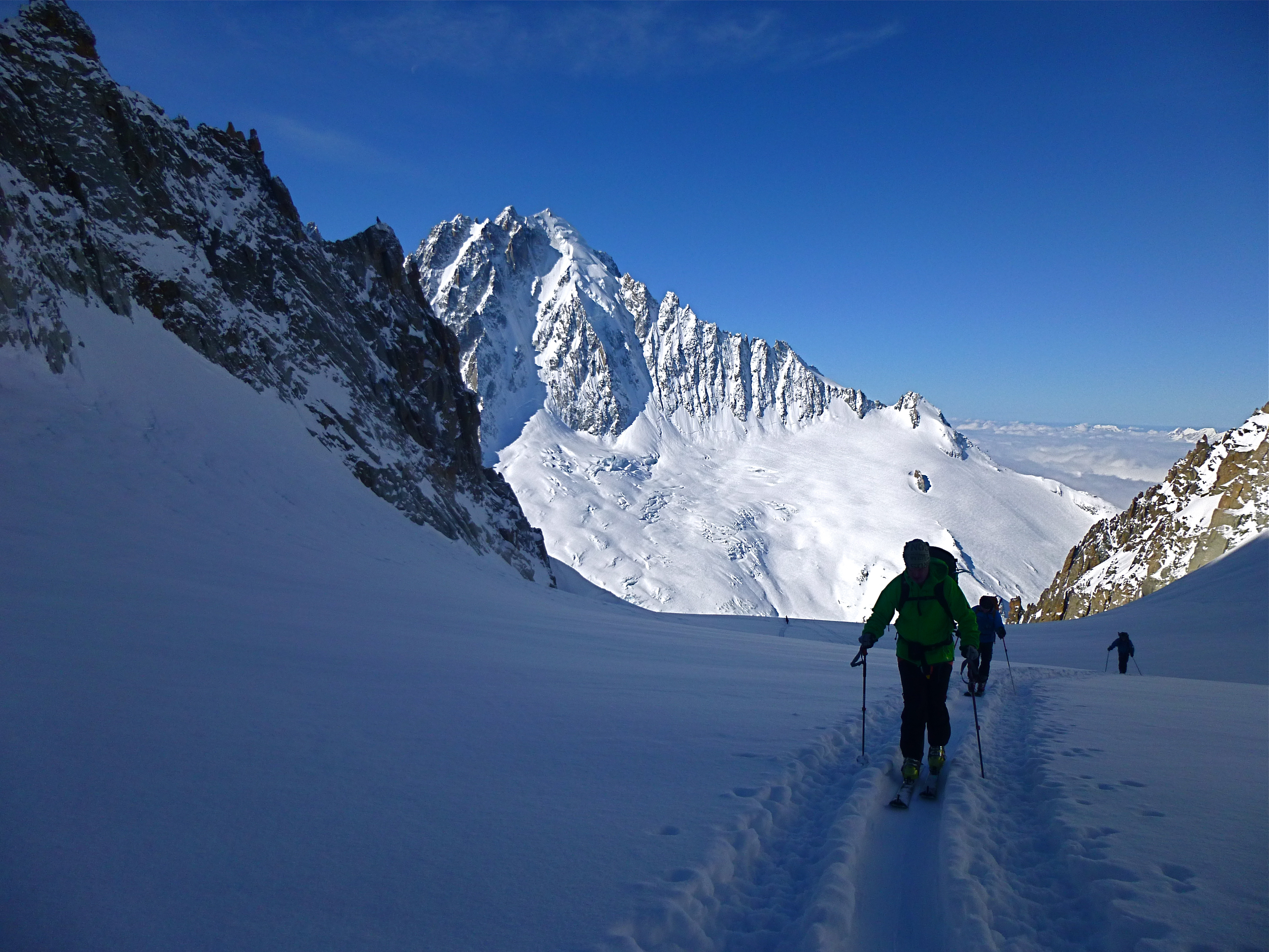 Skinning up to the Col de Chardonnet with the Grand Montets ski area in the background.