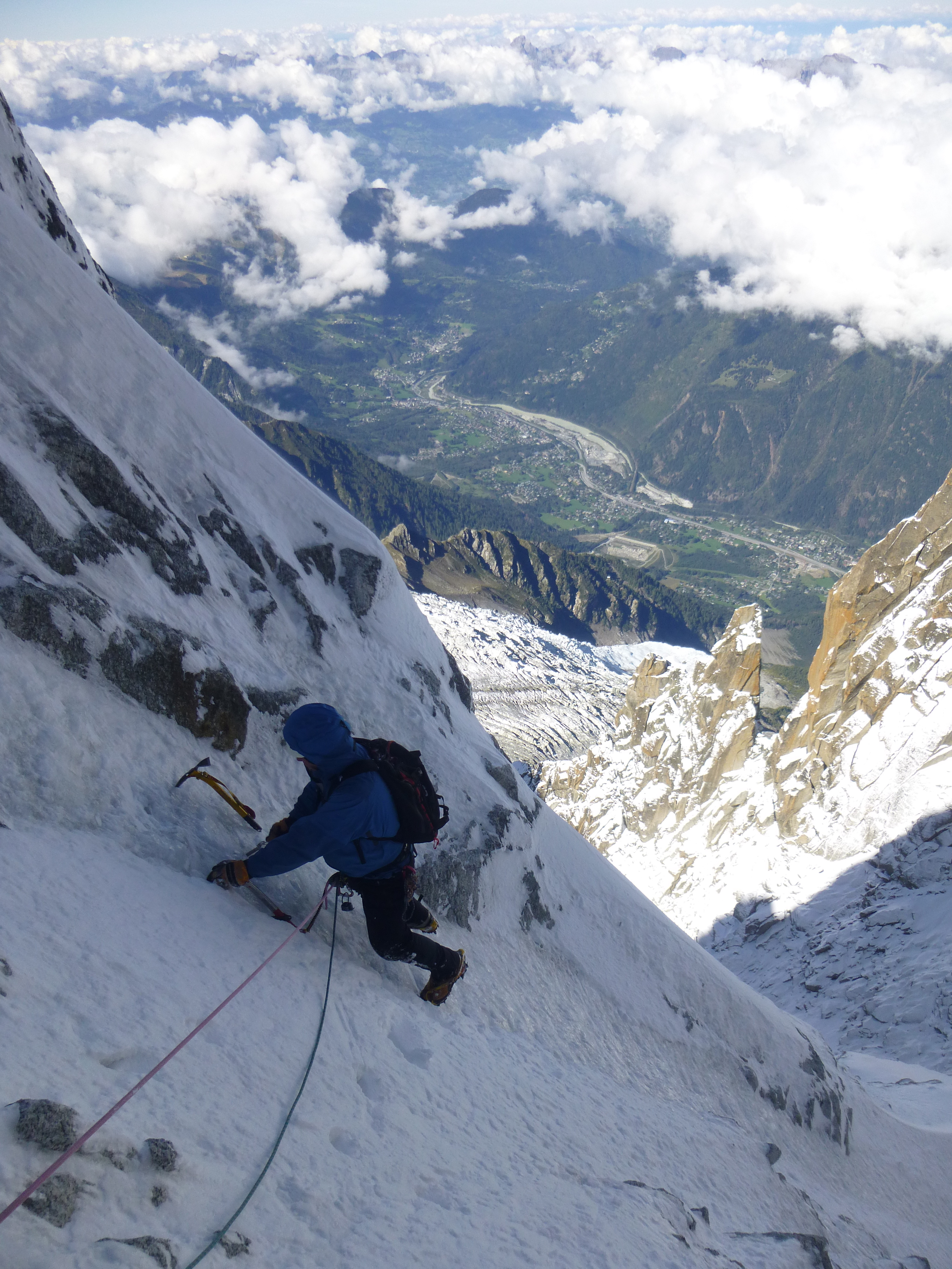 climbing the profit-perroux gully, high above the Chamonix valley